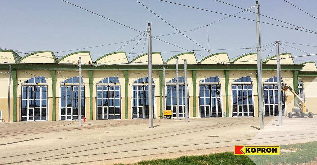 Portoni-a-libro-per-tram-vetrati-Kopron-in-Algeria