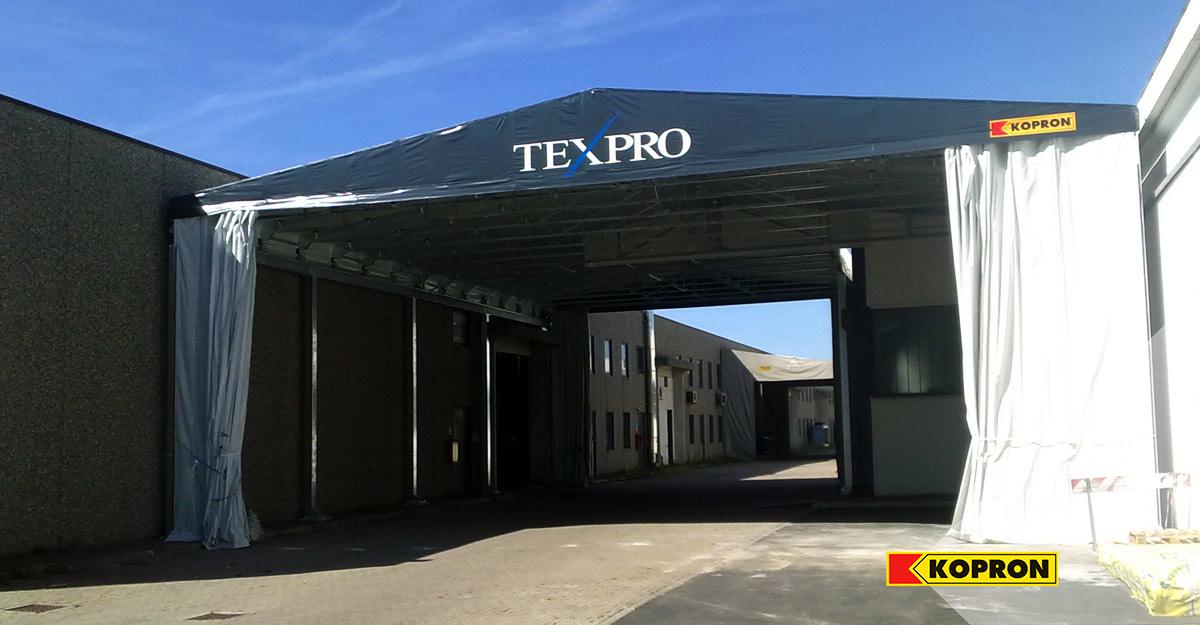 Texpro-sceglie-il-capannone-di-collegamento-Kopron-decorandolo-col-suo-logo