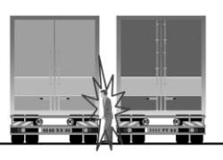 Operatore schiacciato tra due camion