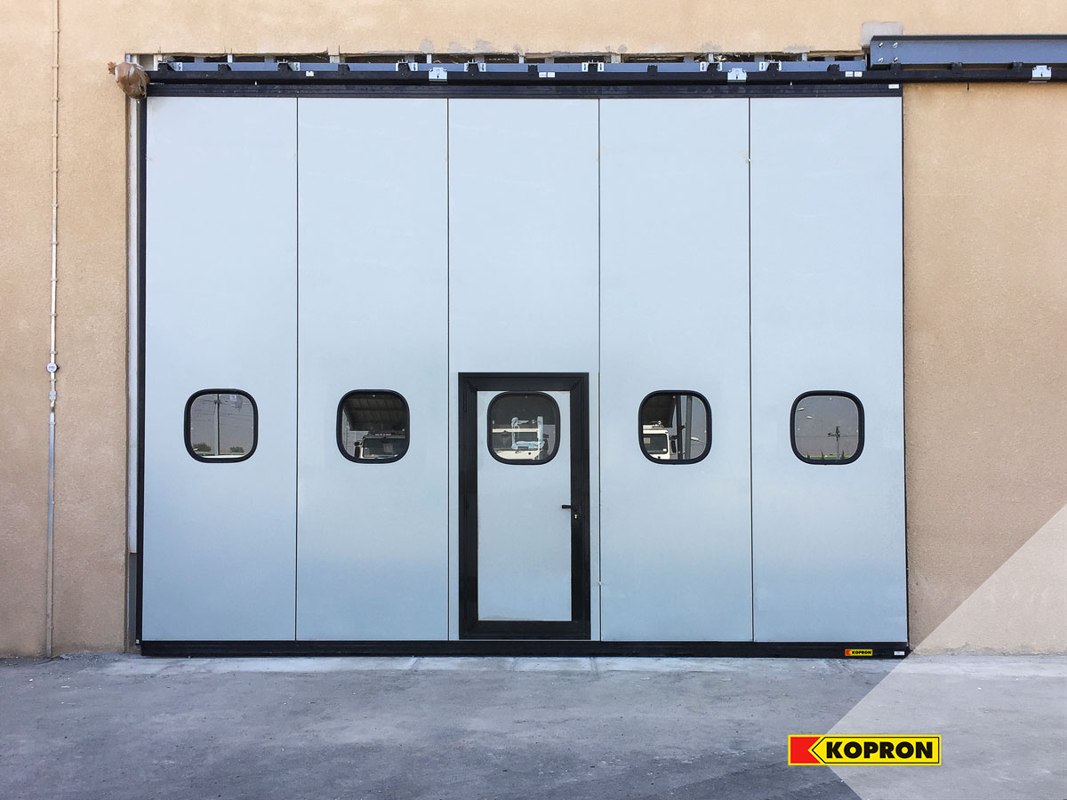 Kopron-folding-doors-with-portholes-in-Algeria