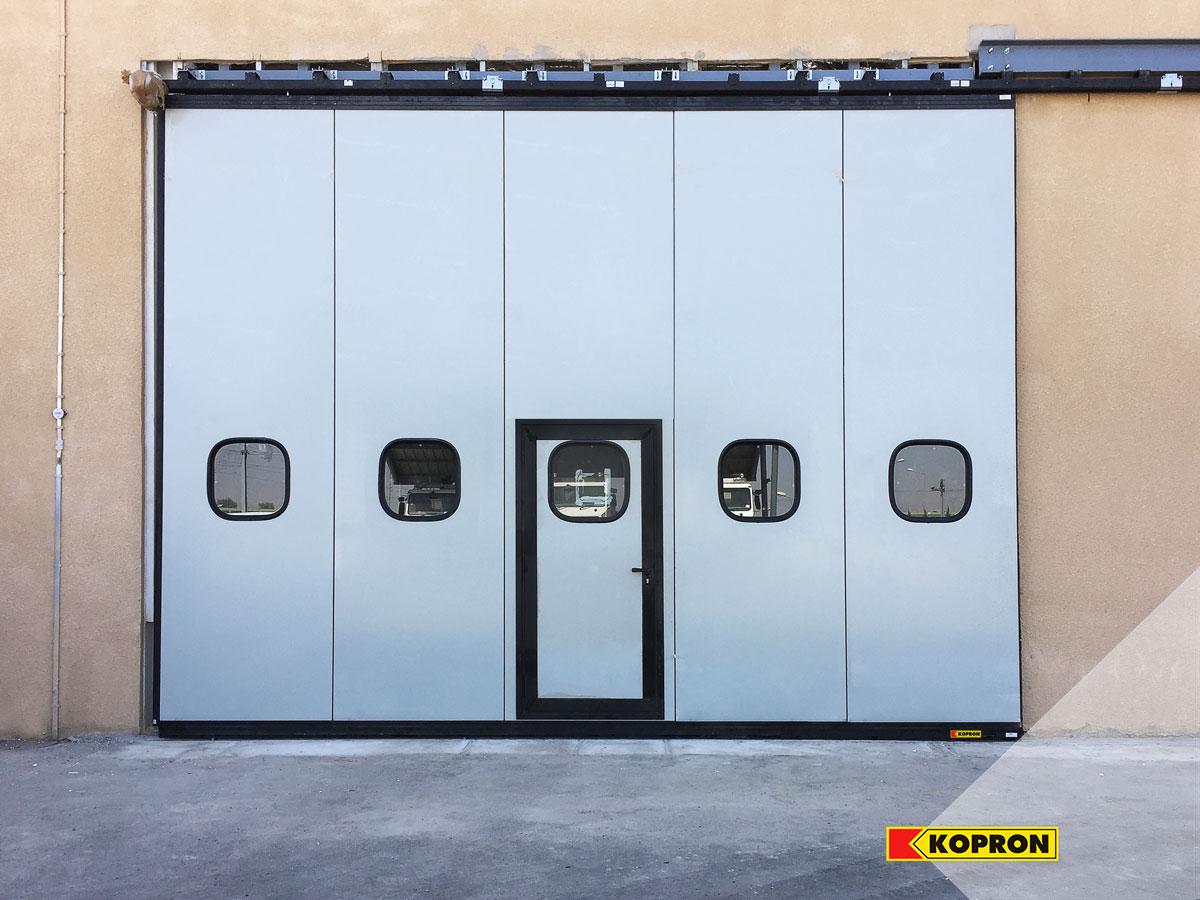 Kopron-folding-doors-with-portholes-in-Algeria